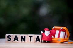 Santa Claus is coming with gift box in suitcase stock photo
