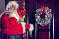 Santa Claus coming in house Royalty Free Stock Photography