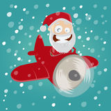 Santa claus is coming with a red plane Stock Photos