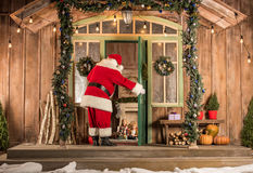 Santa Claus coming to children at Christmas. Time Royalty Free Stock Image