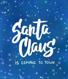 Santa Claus is coming to town text. Holiday greetings quote. Blue background with falling snow effect. Santa Claus is coming to town text, hand drawn brush Royalty Free Stock Images