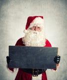 Santa Claus con chalboard Fotografía de archivo libre de regalías