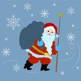 Santa Claus con el bolso lleno de presentes y de copos de nieve Imagenes de archivo