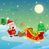 Santa Claus con el regalo de la Navidad en el trineo Imágenes de archivo libres de regalías