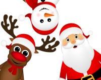 Santa Claus con el reno y una situación del muñeco de nieve Imagen de archivo