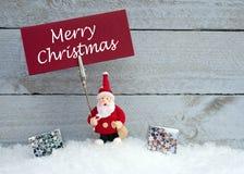 Santa Claus con il segno di Buon Natale Immagine Stock Libera da Diritti