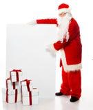 Santa Claus con molti contenitori di regalo Fotografia Stock Libera da Diritti