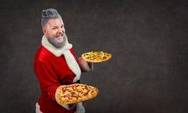 Santa Claus con pizza in mani Fotografia Stock