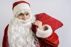Santa Claus con un bolso de regalos Fotos de archivo libres de regalías