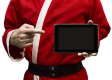 Santa Claus con un PC della compressa Fotografia Stock Libera da Diritti