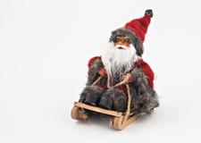 Santa Claus con una barba su un giocattolo dell'albero della slitta isolato Fotografia Stock