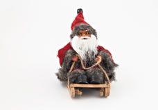 Santa Claus con una barba su un giocattolo dell'albero della slitta isolato Immagine Stock Libera da Diritti