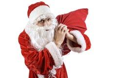 Santa Claus con una borsa dei regali Immagini Stock
