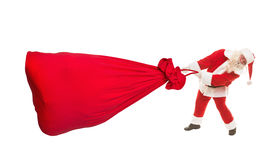 Santa Claus con una borsa molto grande dei regali su un fondo bianco Immagine Stock