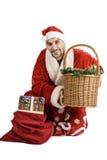 Santa Claus con una cesta del regalo Imágenes de archivo libres de regalías