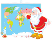 Santa Claus con una mappa di mondo Immagini Stock Libere da Diritti