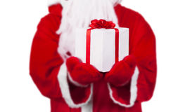 Santa Claus concept. Santa Claus holding gift box Stock Photo