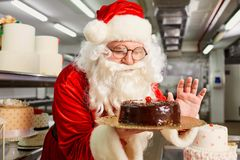 Santa Claus a confectioner cooks a cake in the kitchen on Christ Royalty Free Stock Photos