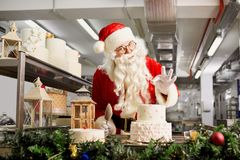 Santa Claus a confectioner cooks a cake in the kitchen on Christ Royalty Free Stock Photography