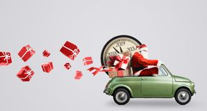Santa Claus countdown on car. Christmas countdown arriving. Santa Claus on car delivering New Year gifts and clock at gray background stock photos
