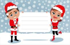 Santa Claus Couple Holding Blank Card Immagine Stock Libera da Diritti