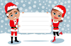 Santa Claus Couple Holding Blank Card Royalty Free Stock Image