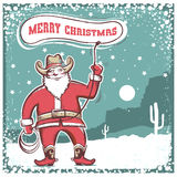 Santa Claus in cowboy boots  twirling a lasso . Royalty Free Stock Photo