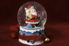 Santa Claus in a crystal water ball Stock Photos