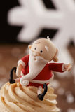 Santa Claus cupcake detail on Christmas background Royalty Free Stock Photo