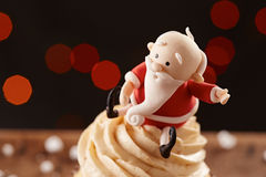 Santa Claus cupcake detail on Christmas background Stock Images
