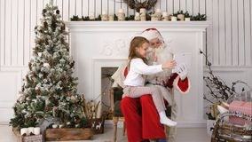 Santa Claus and cute little girl taking Christmas selfies on tablet. Professional shot on Lumix GH4 in 4K resolution. You can use it e.g. in your commercial Stock Images