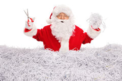 Santa Claus cutting paper with scissors Stock Image
