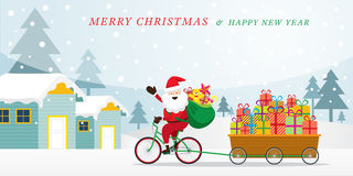 Santa Claus Cycling Bicycles con i contenitori di regalo in carretto Fotografie Stock Libere da Diritti