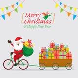 Santa Claus Cycling Bicycles med gåvaaskar i vagn Arkivbild