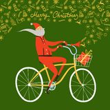 Santa Claus cyclist christmas illustration. Vector illustration with cute Santa Claus on city bicycle with gift box in basket and doodle Christmas drawings Royalty Free Stock Image