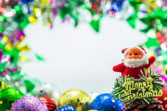 Santa claus dall and Christmas ornaments background Royalty Free Stock Photos