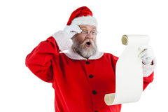 Santa Claus danandeansiktsuttryck, medan läs-, bläddrar Royaltyfria Foton