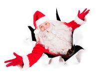 Santa Claus dans un trou du mur de papier Image libre de droits