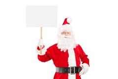 Santa Claus de sorriso que guarda um painel vazio Imagens de Stock