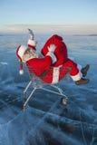 Santa Claus in de vrachtwagen met een zak van giften stock afbeelding