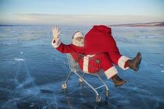 Santa Claus in de vrachtwagen met een zak van giften royalty-vrije stock foto's