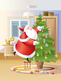 Santa Claus decorate fir Royalty Free Stock Photography