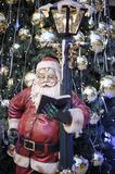 Santa Claus and a decorated Christmas tree Royalty Free Stock Photo
