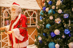 Santa Claus and decorated Christmas tree Stock Photography