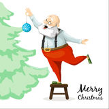 Santa Claus decorates a Christmas tree toy Royalty Free Stock Photography