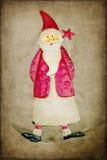 Santa Claus decoration on rustic background Stock Photos