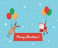 Santa Claus and deer descend on the balloon Royalty Free Stock Images
