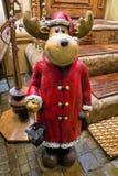 Santa Claus deer - lamp holder. Near the house royalty free stock photo