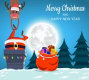 Santa Claus and deer on the roof descend into the chimney. Stock Image