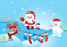 Santa Claus with deer and snowman Royalty Free Stock Photo
